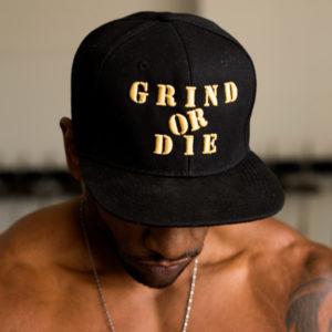 Black and Gold Grind or Die Snap back hat